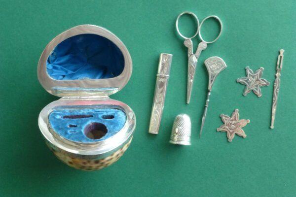 Inhoud zilver naaigerei in een antieke schelp Blog Zilver.nl